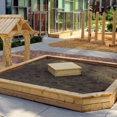 YMCA Natural Play sandbox and play house