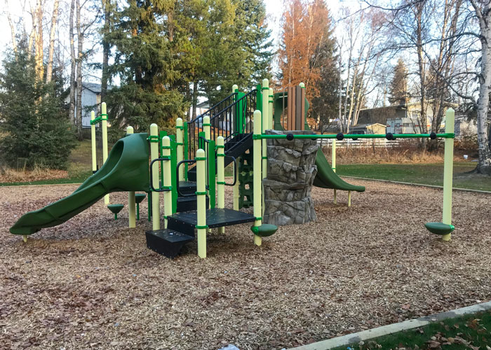Starlane playground with slide and rock climbing structure