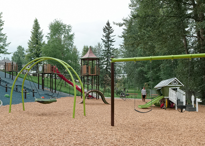 playground on a hillside with climbing nets and slide