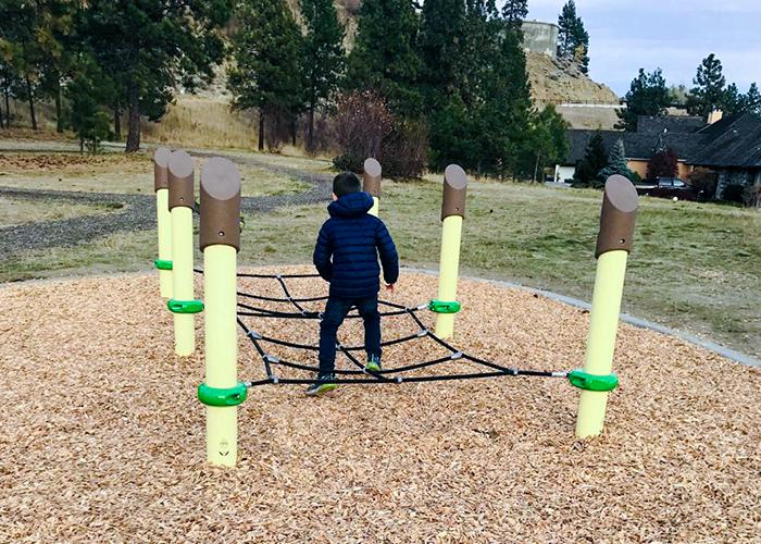 boy jumpingthrough play net