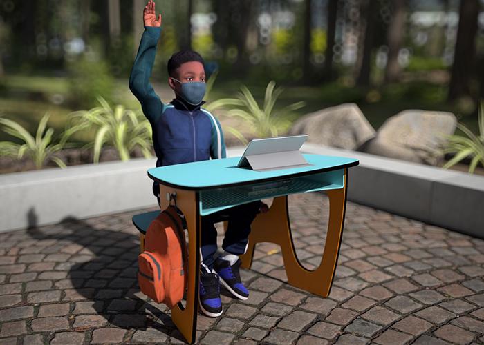 children sitting in outdoor desks