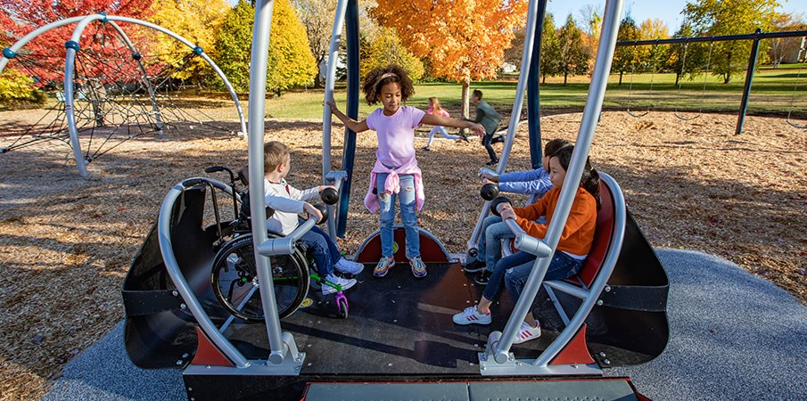 Accessible swing with child in wheelchair