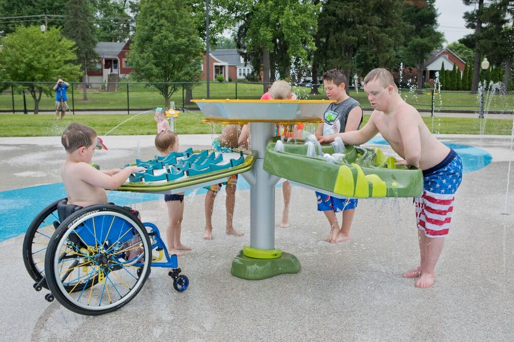 a splash pad design with children playing at a water table