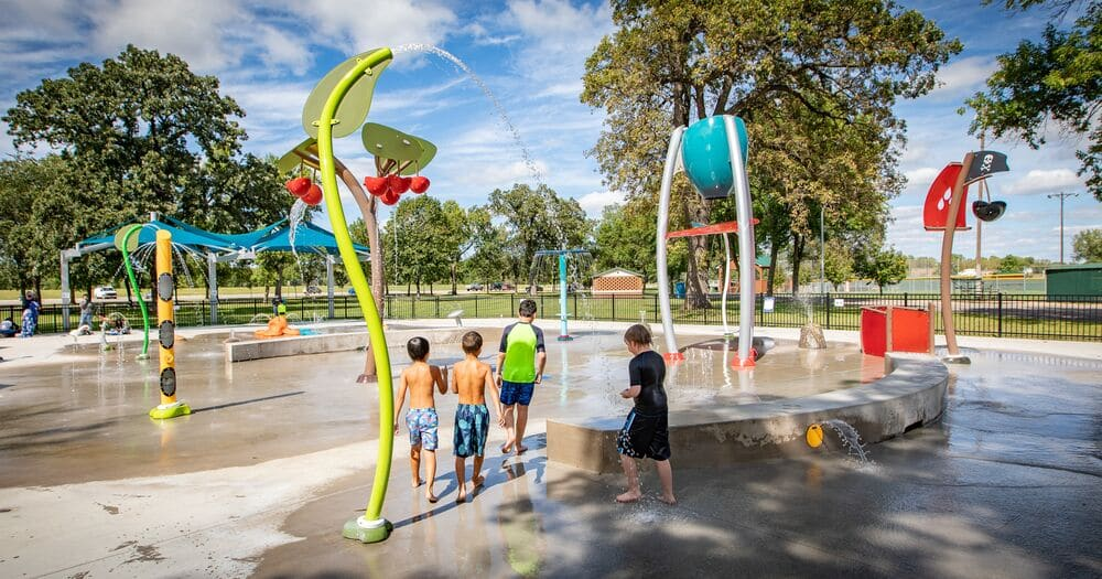 splash pad design with colourful posts and kids playing