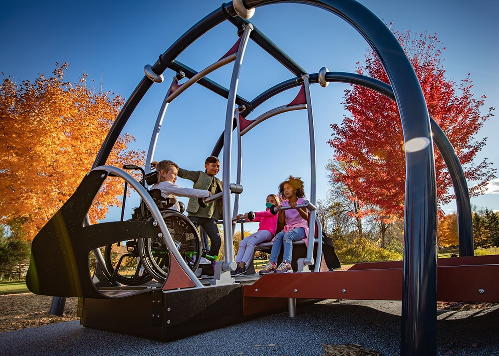 Inclusive Playground Design swing with wheelchair user