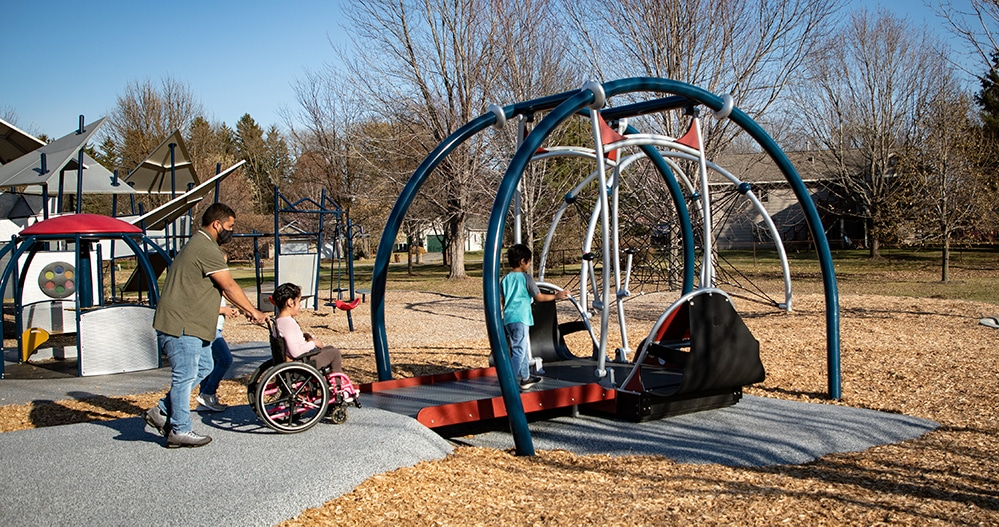 Inclusive Playground Design featuring a swing for wheelchairs