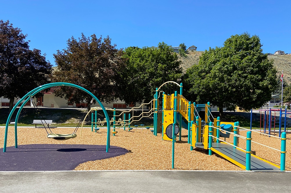 Westmount Elementary's inclusive playground design featuring an accessible swing and ramps