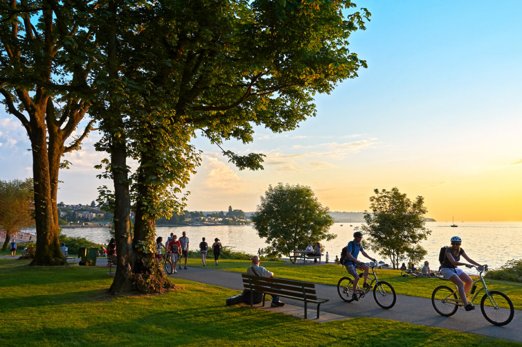 People cycling on waterfront park