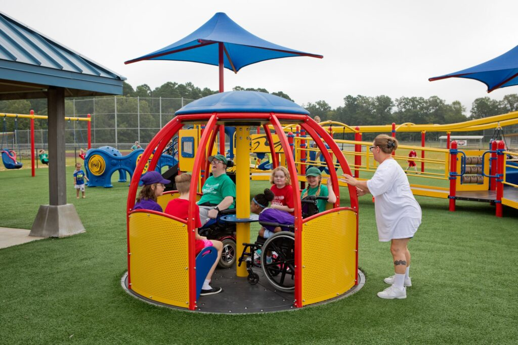 Playground spinner on artificial turf