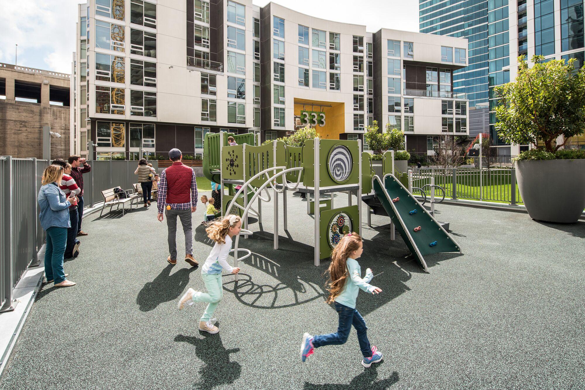 Rooftop Playground with children running