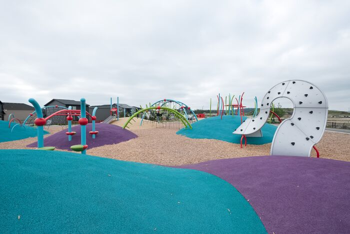 colourful playground on mounded poured-in-place rubber surfacing