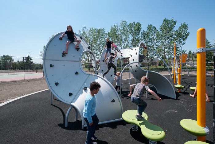 Orange playground at harvest hills in Calgary